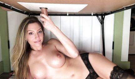 Подружка с большими сиськами делает минет под столом и дрочит член руками